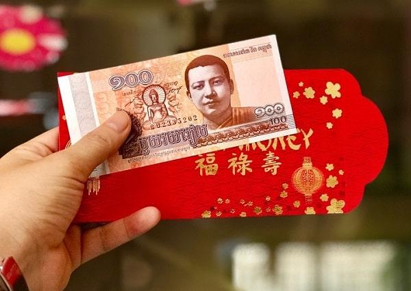 Đồng 100 Riel có hình tượng Phật được nhiều người đổi để lì xì lấy may trong năm mới